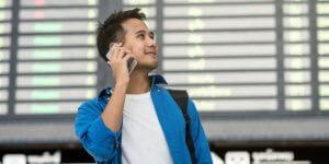 Man calling phone in airport
