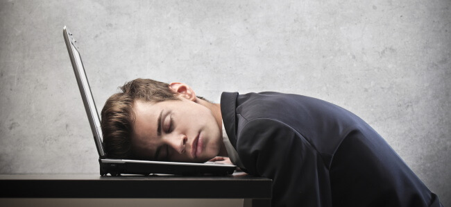 Man tired sleeping on computer