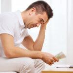 Sad man with money