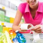 Supermarket woman checking receipt